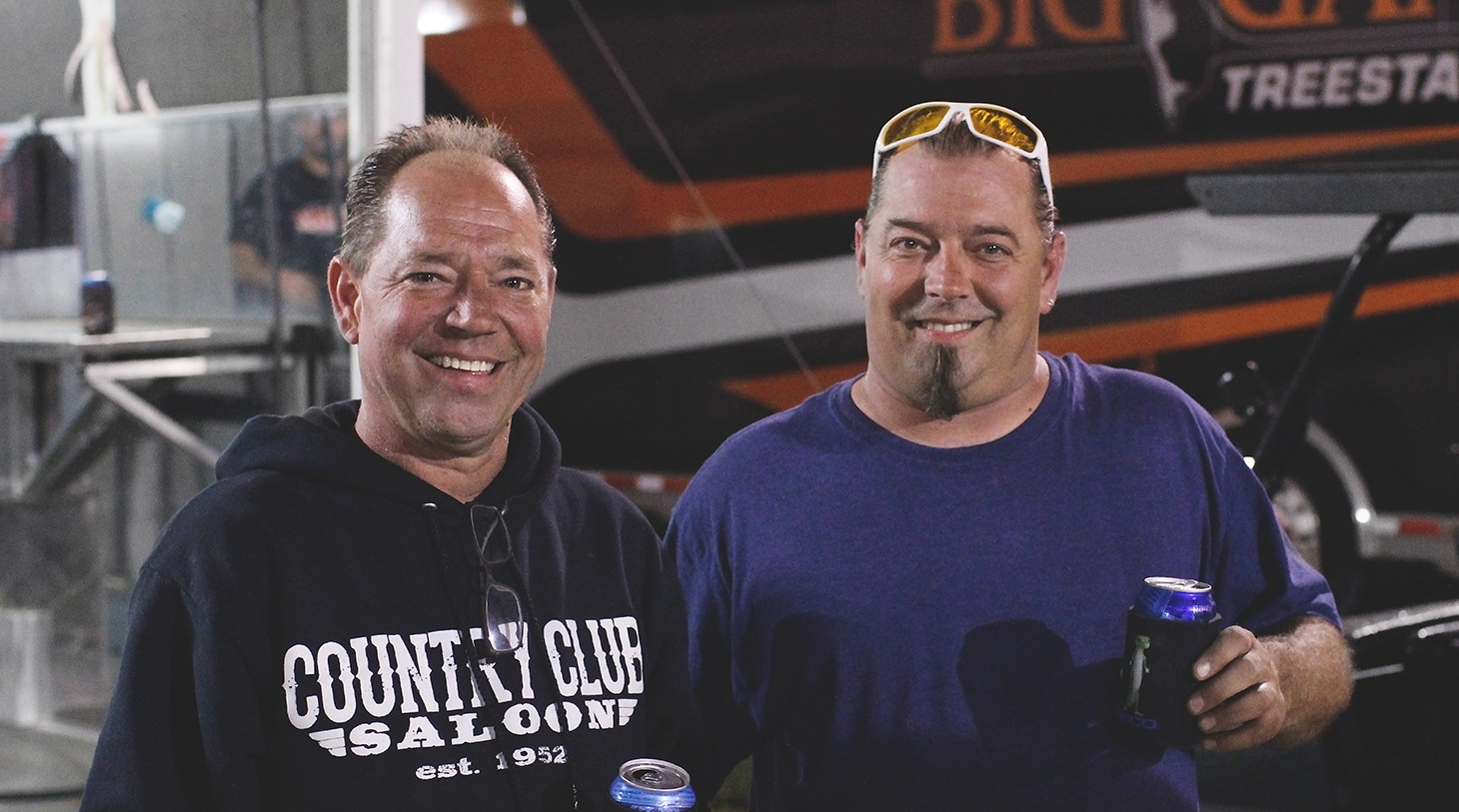 Jason and Paul Sides share a drink after the feature at Weedsport with The World of Outlaws