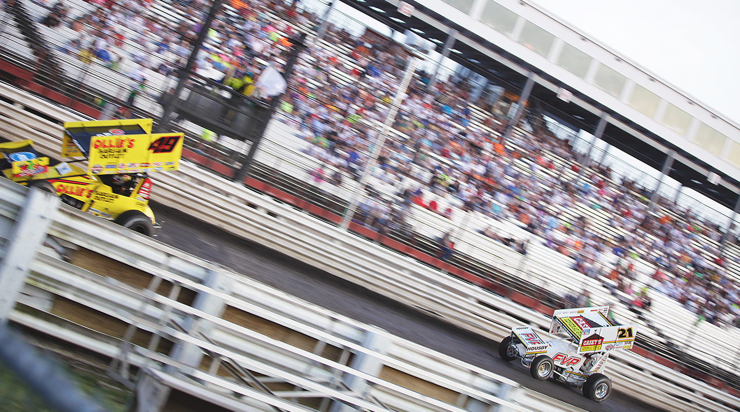 Brian Brown chasing Brad Sweet down the frontstretch during heats at Knoxville